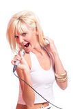 Blond girl singing Royalty Free Stock Image