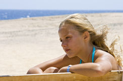 Blond girl sitting on the bench Royalty Free Stock Images