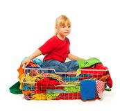 Blond girl sitting in the clothes basket Stock Photography