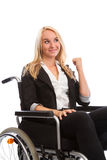 Blond girl sitting in a wheel chair Royalty Free Stock Photography