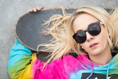 Blond Girl with Skateboard. Pretty blond girl with skateboard royalty free stock images