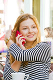 Blond girl with smart phone Royalty Free Stock Photo