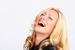 Blond girl smiling Royalty Free Stock Photos