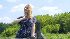 Blond girl smiling on the summer landscape . Positive human emotion facial expression feelings. Attitude, perception stock video