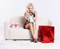 Blond girl on sofa Royalty Free Stock Photo