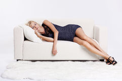 Blond girl on sofa Stock Image