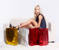 Blond girl on sofa Royalty Free Stock Photography