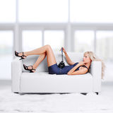 Blond girl on sofa Stock Images