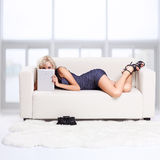 Blond girl on sofa Royalty Free Stock Photo