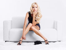 Blond girl on sofa Royalty Free Stock Images