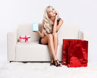 Blond girl on sofa Stock Photo