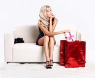 Blond girl on sofa Royalty Free Stock Photos