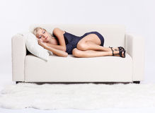 Blond girl on sofa Stock Photography