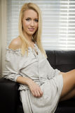 Blond girl on a sofa Royalty Free Stock Image