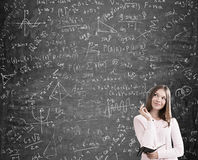 Blond girl solving a difficult problem Stock Photography