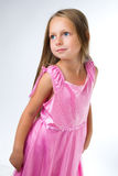 Blond girl stand in pink dress Royalty Free Stock Images