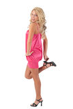 Blond girl standing on one foot Stock Photos