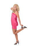 Blond girl standing on one foot Stock Images