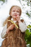 Blond girl standing pensive royalty free stock photo