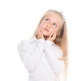 Blond girl stares upwards Stock Photography