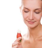 Blond girl with a strawberry Stock Photos