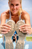 Blond girl stretches Stock Photos