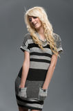 Blond girl in striped clothes studio shot Stock Photos