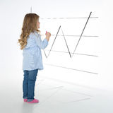 Blond girl studying chart Royalty Free Stock Photo