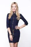 Blond girl styling a luxury zip dress Stock Image