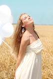 Blond girl in the summer field Royalty Free Stock Photos