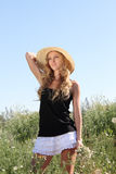 Blond girl on the summer meadow Stock Images