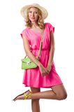 Blond girl in summer pink clothing isolated on Royalty Free Stock Photography