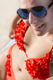 Blond girl sunbathing in a bikini Royalty Free Stock Images