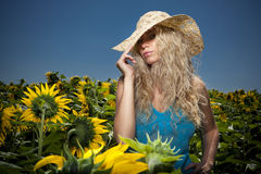 Blond girl in sunflowers Royalty Free Stock Photography