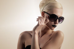 Blond girl with sunglasses Royalty Free Stock Photography
