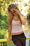 Blond girl with sunglasses Royalty Free Stock Images