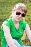 Blond girl in sunglasses Stock Image