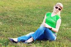 Blond girl in sunglasses Stock Images