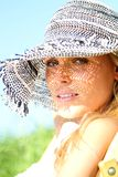 Blond Girl with a sunhat Stock Image