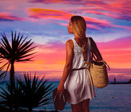 Blond girl sunset Andratx Mallorca port sunset. Blond tourist girl sunset in Andratx Mallorca port sunset photomount Royalty Free Stock Image