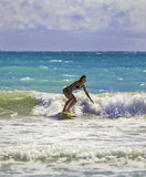 Blond girl surfing the waves Royalty Free Stock Image