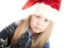 Blond girl in a sweater and a Christmas hat. Cute Blond girl in a sweater and a Christmas hat Stock Image