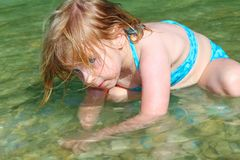 Blond girl swimming in lake river Stock Photo