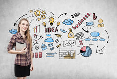 Blond girl with tablet and business sketch Stock Photo