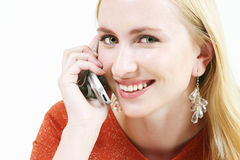 Blond girl talking 2. Young blond girl on mobile phone royalty free stock image
