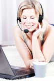 Blond girl talking on the headset. Stock Photography