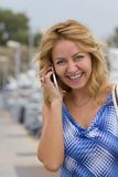 Blond girl talking on the phone Royalty Free Stock Photo