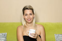Blond girl with tea Royalty Free Stock Images