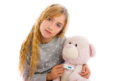 Blond girl with teddy bear thermometer and flu Royalty Free Stock Images