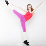 Blond girl in tension in gymnastic pose Royalty Free Stock Photography